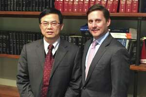 Dr. Keping Xie (left) with his attorney, Nathan Mays, after a Harris County Grand Jury declined to indict Xie on November 28, 2018. The cancer researcher was arrested earlier this year on charges of possession of child pornography, a charge he vehemently denied.