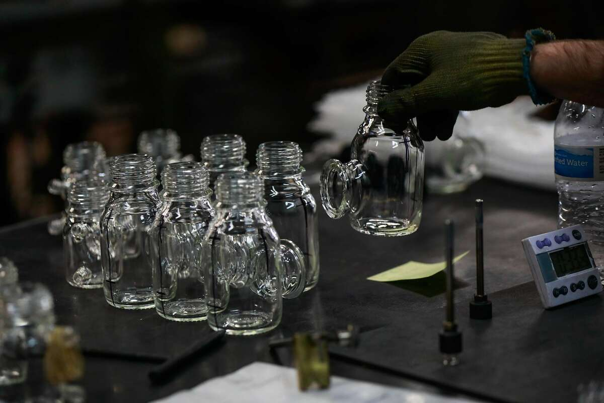 Sam Merkel organizes glassware at Adams & Chittenden, a 25-year-old scientific glass blowing company in Berkeley, California, on Tuesday, Nov. 27, 2018.