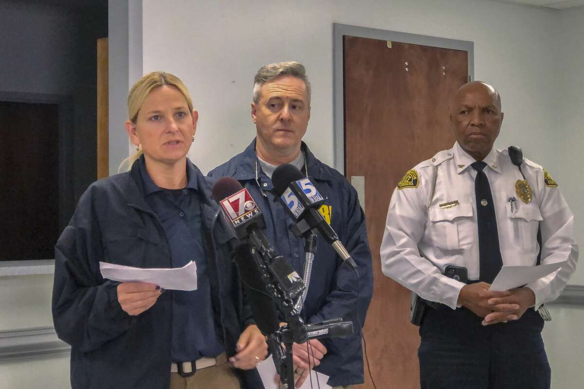 Special Agent Liza Vita of the Federal Bureal of Investigation speaks to the news media on Monday, Nov. 12, 2018, in Lumberton, N.C., about the ongoing search for 13-year-old Hania Noelia Aguilar. Hania was reported kidnapped from the front yard of her home in Lumberton on Nov. 5. With Vita are FBI supervisor Andy de la Rocha and Lumberton Police Chief Michael McNeill. (Paul Woolverton/The Fayetteville Observer via AP)