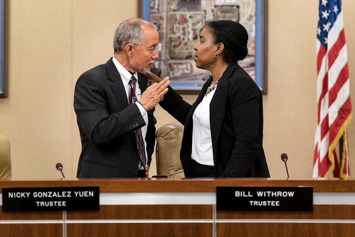 Peralta Community College District Trustee Nicky Gonz�lez Yuen, left, and Board President Meredith Brown speak together following a Peralta Community College District board meeting in Oakland, California, on Tuesday, November 27, 2018, where the Peralta Board of Trustees considers whether to censure Trustee Yuen because he has spoken publicly, against board policy, about problems in the district.