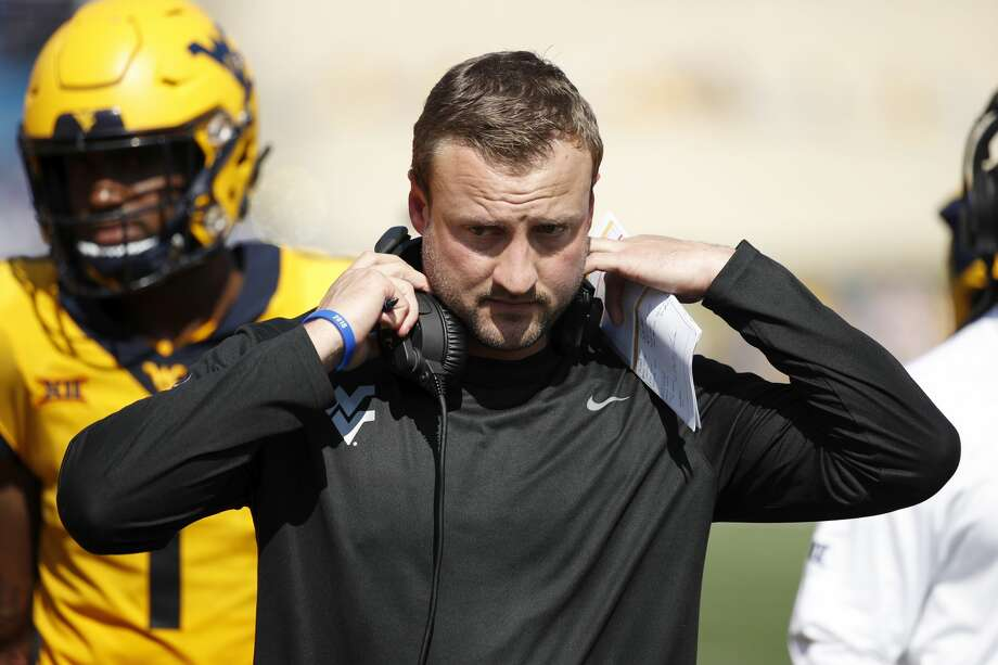 MORGANTOWN, WV - OCTOBER 06: Offensive coordinator Jake Spavital of the West Virginia Mountaineers looks on during the game against the Kansas Jayhawks at Mountaineer Field on October 6, 2018 in Morgantown, West Virginia. The Mountaineers won 38-22. (Photo by Joe Robbins/Getty Images) Photo: Joe Robbins/Getty Images
