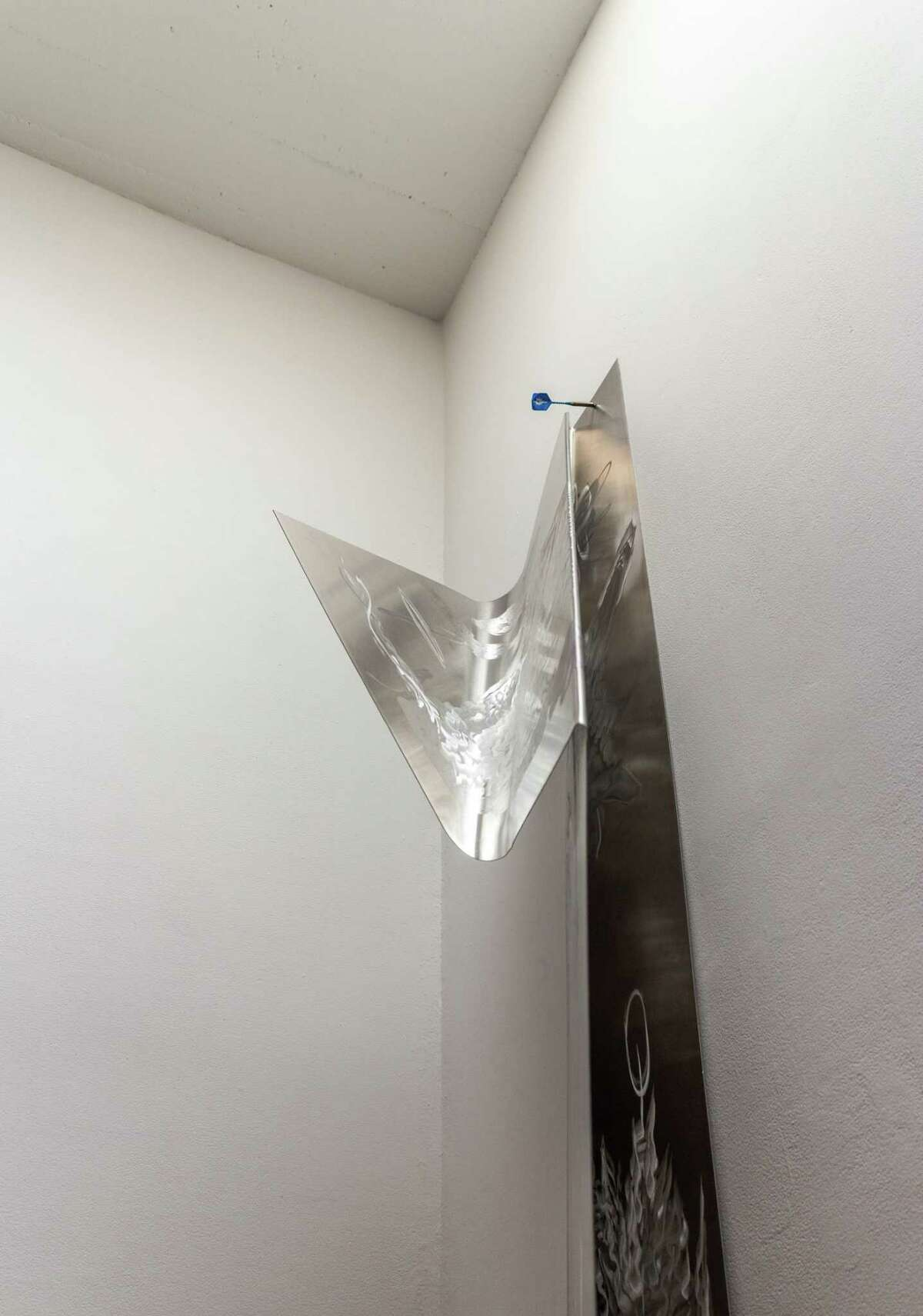 """Artist Alice Khalilova's """"Axon Budged"""" installation at Artpace includes """"Lyre and Bow,"""" a piece made from etched aluminum, insulation foam anda dart."""