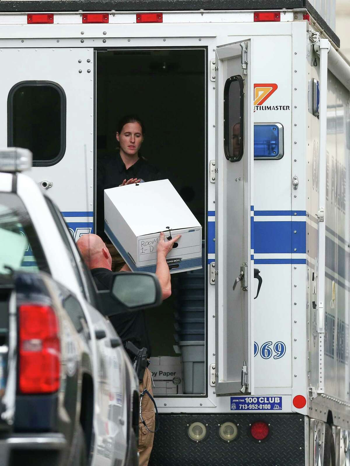 Authorities load up an evidence box into a Conroe Police Department vehicle as they conduct a search warrant of the Chancery of the Archdiocese of Galveston-Houston on Wednesday.