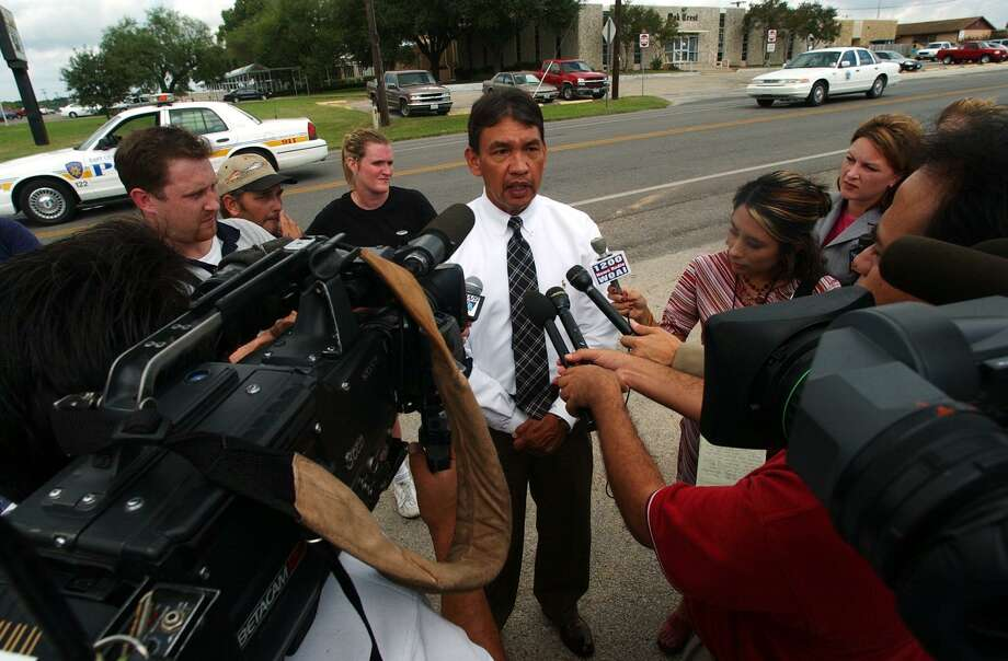 In September 2003, East Central School District Executive Director of Student Services Clyde Peacock talks with the media after a lock down of East Central High School after a report of a man with a gun was made. A search turned up nothing. Fifteen years later, the district is considering arming teachers. Photo: JERRY LARA /SAN ANTONIO EXPRESS-NEWS / SAN ANTONIO EXPRESS-NEWS