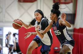 COLORADO SPRINGS, CO - MAY 25: Haley Jones #85 of Santa Cruz, Calif. drives to the hoop in front of Sahara Jones #155 of San Antonio, Texas as they participate in tryouts for the 2018 USA Basketball Women's U17 World Cup Team at the United States Olympic Training Center in Colorado Springs, Colorado. Finalists for the team will be announced on May 28 and will remain in Colorado Springs for training camp through May 30. (Photo by Marc Piscotty/Icon Sportswire via Getty Images)