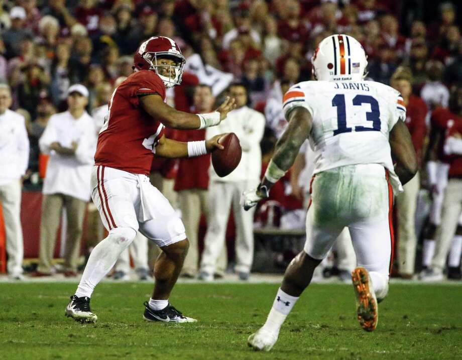 Alabama quarterback Tua Tagovailoa throws a pass against Auburn during the second half on Saturday. Photo: Butch Dill / Associated Press / Copyright 2018 The Associated Press. All rights reserved.