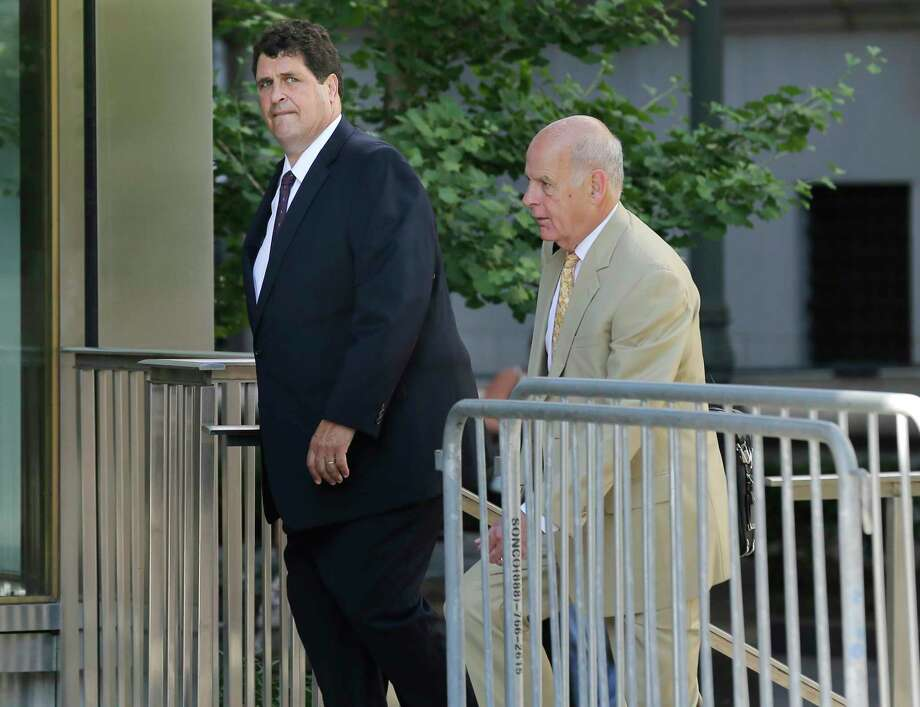 Steven Aiello, left, arrives to federal court in New York, Tuesday, July 10, 2018. A former president of the State University of New York's Polytechnic Institute and several businessmen tried desperately to hide a conspiracy to steer contracts worth hundreds of millions of dollars in an ambitious upstate New York redevelopment plan known as the Buffalo Billion, a prosecutor told jurors in closing arguments at a corruption trial Monday. (AP Photo/Seth Wenig) Photo: Seth Wenig / Copyright 2018 The Associated Press. All rights reserved.