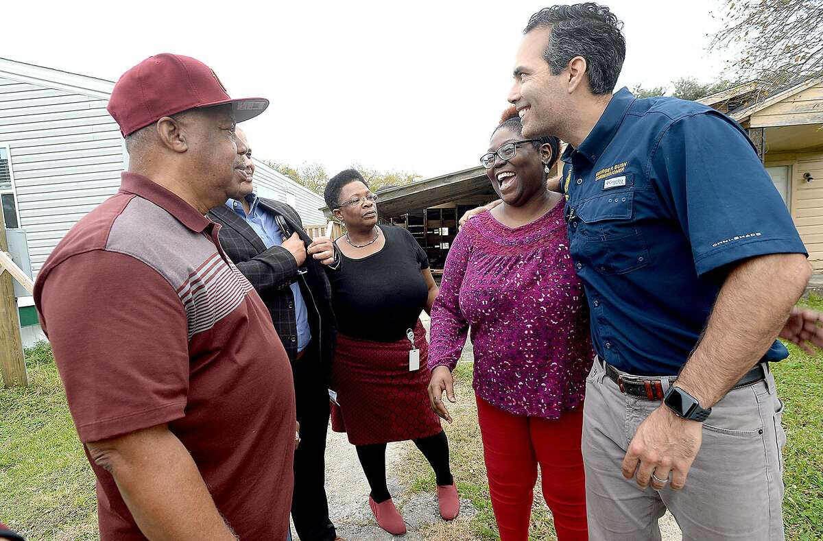 Texas Land Commissioner George P. Bush hugs Havalisia Owens as he meets with her and Port Arthur officials, including (from left) city councilman Cal Jones, Mayor Derrick Freeman and Rhonda Masters with the General Land Office, during a stop in Jefferson County Wednesday. Ms. Owens lost everything at her life-long home of 43 years in Port Arthur after it filled with over 5' of water during Harvey, and she and daighter Audrea Broussard have been living in a FEMA trailer for over a year. She is among the homeowners the GLO is looking to assist throughout the region in their new Homeowner Assistance Program, which started Wednesday. They also announced a FEMA extension on trailers as well as a new sales program. Photo taken Wednesday, November 28, 2018 Kim Brent/The Enterprise