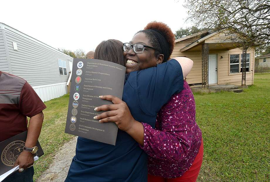 Port Arthur resident Havalisia Owens gets a hug from General Land Office employee Brittany Eck after receiving her application materials for their new assistance program during a stop and visit with Texas Land Commissioner George P. Bush Wednesday. The Texas General Land Office rolled out their newest Homeowner Assistance Program in the region to further aid those still recovering from Tropical Storm Harvey. They also announced a FEMA extension on trailers as well as a new sales program.  Photo taken Wednesday, November 28, 2018  Kim Brent/The Enterprise Photo: Kim Brent / The Enterprise / BEN