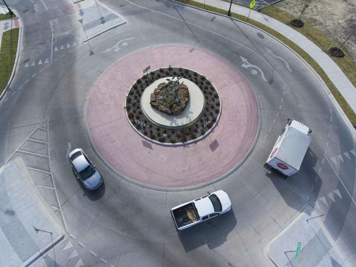 Traffic moves Wednesday, Nov. 28, 2018 through the city's new and only two-lane roundabout in downtown San Antonio near the Central Library.
