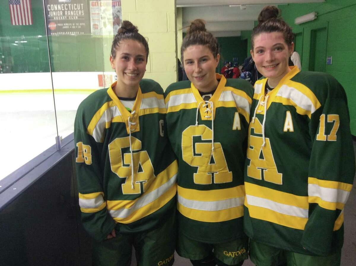 From left to right, Bobbi Roca, Grace Curran and Paige Keating are senior captains on the Greenwich Academy hockey team