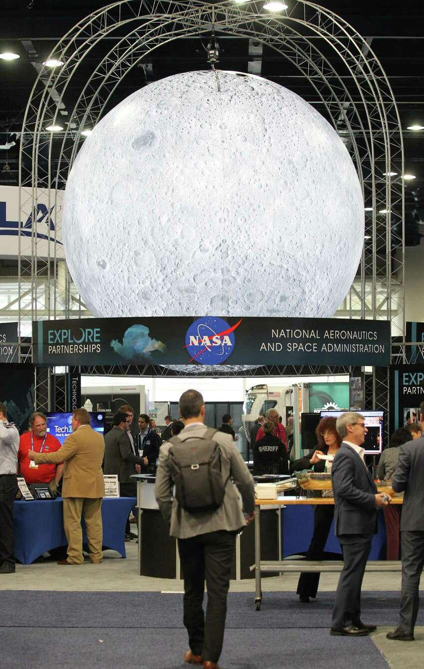 A large moon over NASA's display is on the show floor at the annual SpaceCom (Space Commerce Conference and Exposition) Tuesday, Nov. 27, 2018, in Houston.