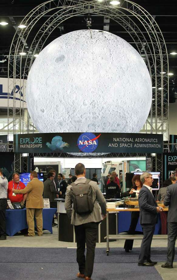 A large moon over NASA's display is on the show floor at the annual SpaceCom (Space Commerce Conference and Exposition) Tuesday, Nov. 27, 2018, in Houston. Photo: Steve Gonzales, Houston Chronicle / Staff Photographer / © 2018 Houston Chronicle