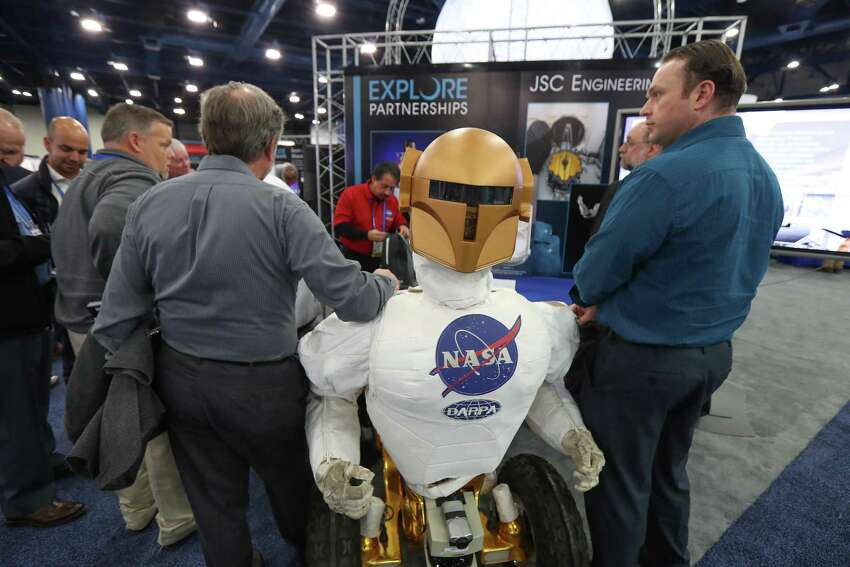 A Johnson Space Center Tele Robot is on display on the show floor at the annual SpaceCom (Space Commerce Conference and Exposition) Tuesday, Nov. 27, 2018, in Houston.