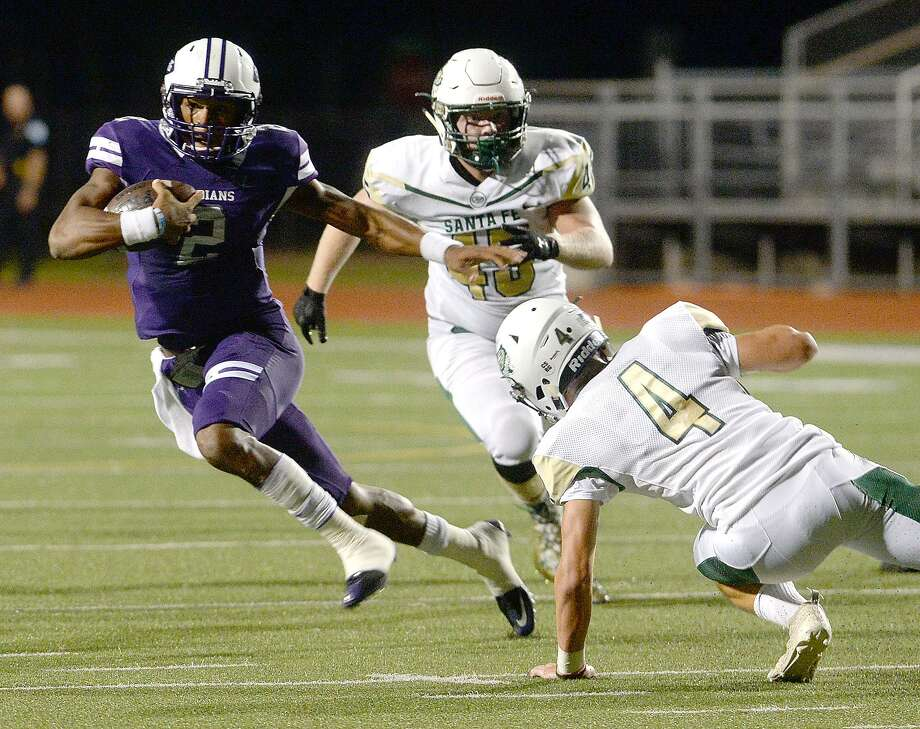 Port Neches-Groves quarterback Roschon Johnson skirts past Santa Fe's defense en route to a touchdown run on Oct. 26. Photo: Kim Brent / The Enterprise / BEN