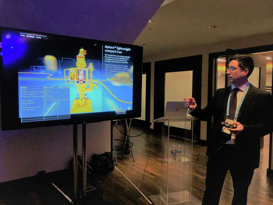 Juan Benedetti with London office of Baker Hughes uses a video game controller to demonstrate new technology the Houston-based oil field service company will reduce costs for offshore projects. NEXT: See photos from the 2018 Offshore Technology Conference in Houston. Photo: Sergio Chapa / Houston Chronicle