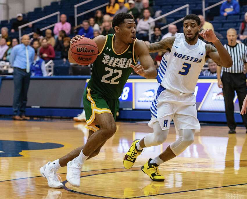 Siena guard Jalen Pickett (22) drives on Hofstra guard Justin Wright-Foreman (3) during the first half of their men's basketball game at Hofstra on Wednesday, Nov. 28, 2018