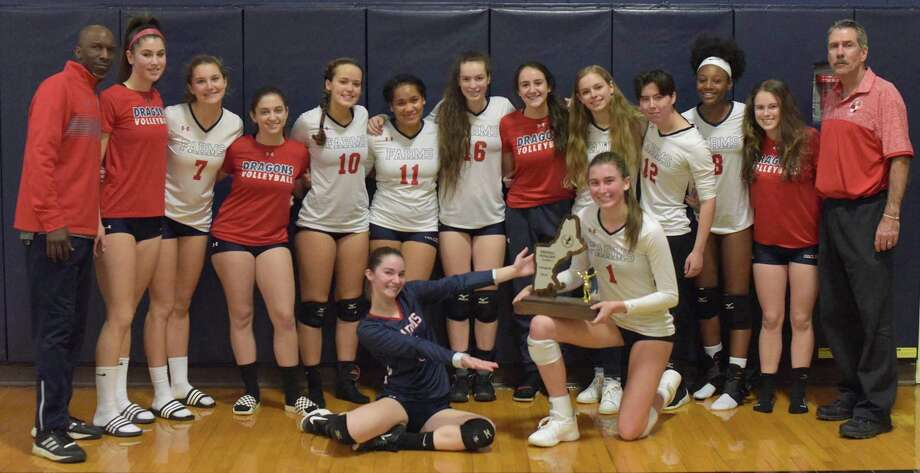 The Greens Farms Academy varsity volleyball team poses for a photo with the New England Class C runner-up trophy after falling to King in the final last week. Photo: Greens Farms Academy Athletics Contributed Photo / Contributed Photo