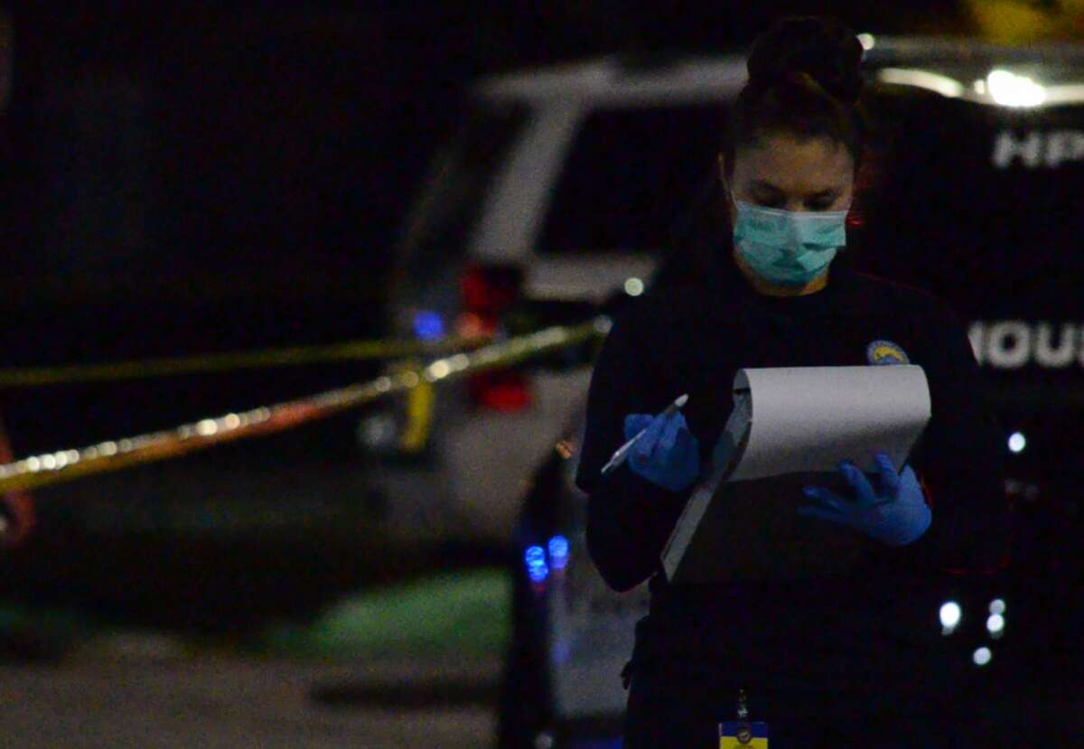 Houston police officers investigate a deadly shooting in Spring Branch on Wednesday, Nov. 28, 2018.