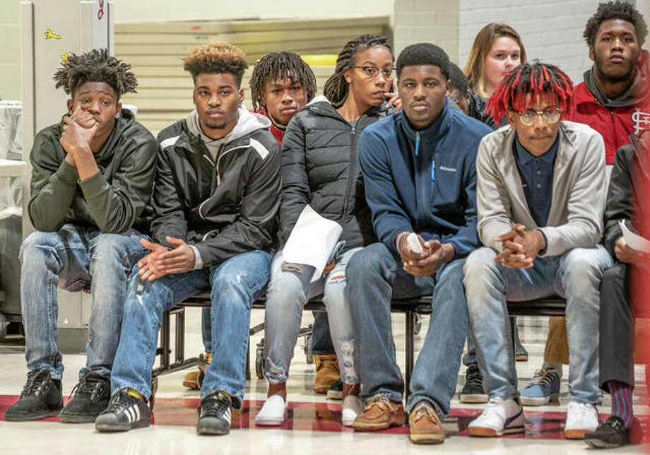 Members of the Alton High School basketball team, along with family and friends, listen to Judge Luther Simmons speak in front of the Alton School Board Wednesday during a special meeting to discuss an in-game fight last Friday during a home game against Riverview. Individuals in the photo did not necessarily engage in the incident. The entire Alton team attended the meeting. Simmons advised the team to use the incident as a learning experience. Photo: Nathan Woodside | The Telegraph