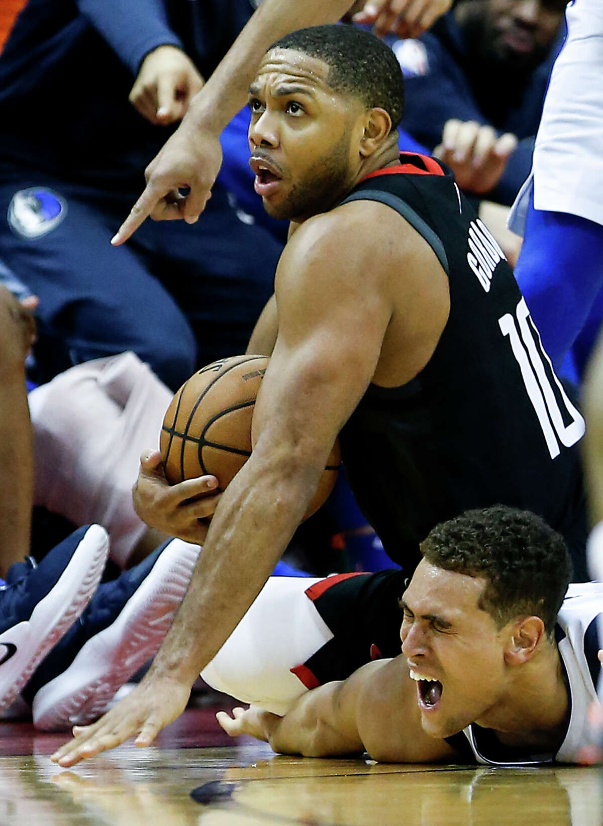 Houston Rockets guard Eric Gordon (10) and Dallas Mavericks forward Dwight Powell go to the floor after a loose ball during the second half of an NBA basketball game at Toyota Center on Wednesday, Nov. 28, 2018, in Houston.