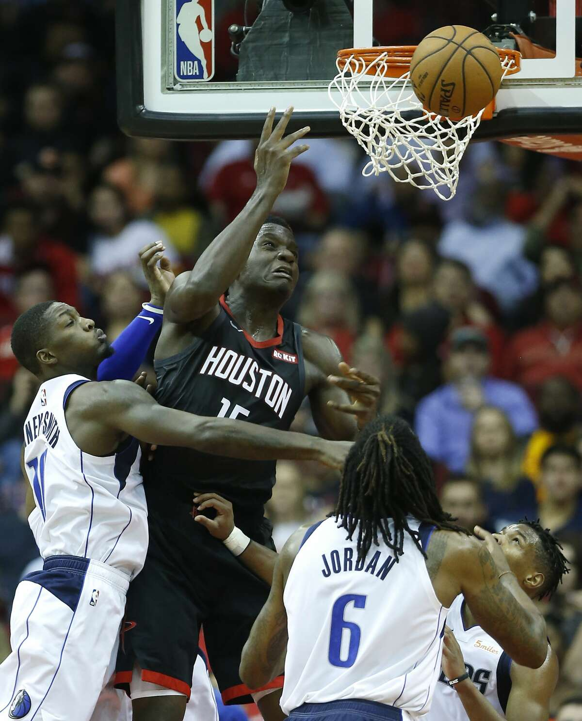 Houston Rockets center Clint Capela (15) misses a shot at the basket as he goes up against Dallas Mavericks forward Dorian Finney-Smith (10) and center DeAndre Jordan (6) during the second half of an NBA basketball game at Toyota Center on Wednesday, Nov. 28, 2018, in Houston.