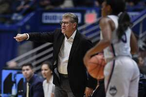 UConn coach Geno Auriemma gestures to his team during the second half against DePaul in Hartford Wednesday. (AP Photo/Jessica Hill)