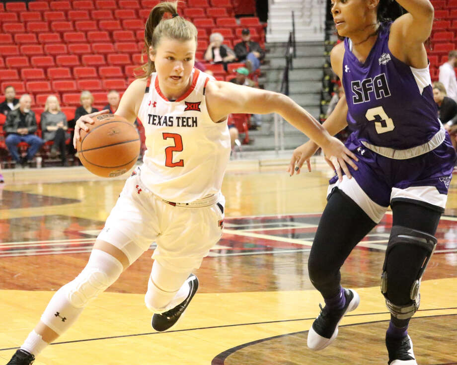 Texas Tech sophomore guard Sydney Goodson tries to drive around Stephen F. Austin junior guard Chanell Hayes during women's basketball action on Wednesday at United Supermarkets Arena in Lubbock. The Lady Raiders won, 77-69. Photo: Tyler Anderson/Amarillo Globe-News