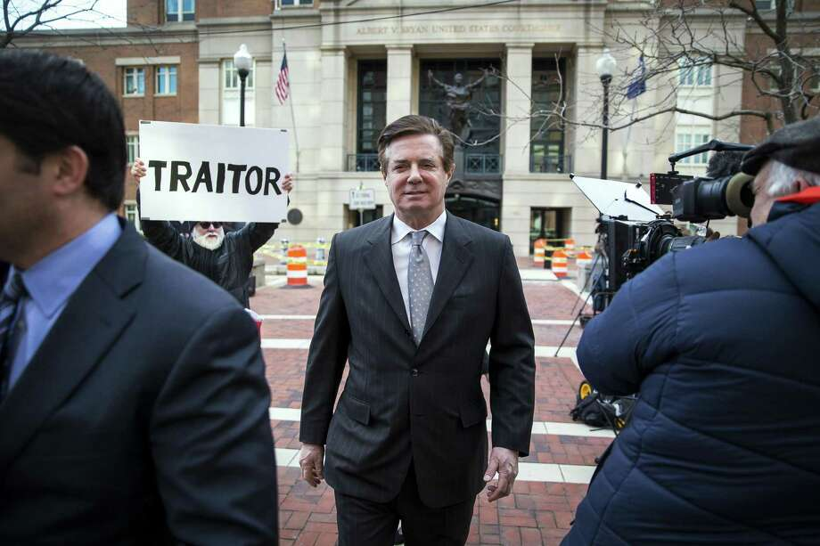 Paul Manafort, President Donald Trump's former campaign chairman, leaves the federal courthouse after his arraignment hearing in Alexandria, Va., March 8, 2018. Manafort was found guilty of charges for tax evasion and bank fraud. (Al Drago/The New York Times) Photo: AL DRAGO, STR / NYT / NYTNS