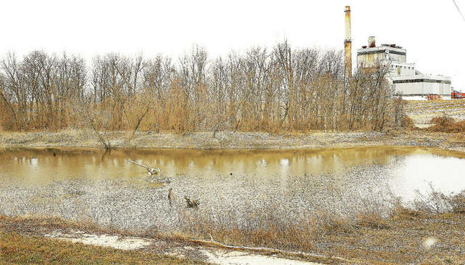The Luminant-owned power station at 1 Chessen Lane in East Alton sits right next to Wood River Creek near where it spills into the Mississippi River. A report released Wednesday details increased health risks due to coal ash contaminating groundwater in Illinois. Photo: John Badman | The Telegraph