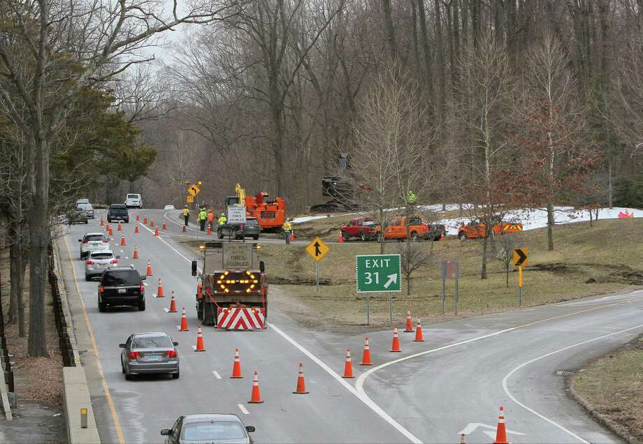 A crew from the Connecticut Department of Transportation clear trees along the Northbound Merritt Parkway at exit #31 for North Street in Greenwich, Conn. on Tuesday, March 27, 2018. More tree removal work is planned for Dec. 1-2, 2018. Photo: Matthew Brown / Hearst Connecticut Media / Stamford Advocate