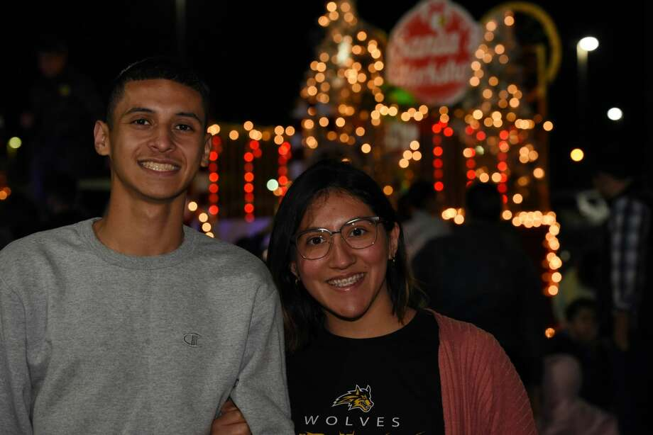 Attendees pose for a photo during the Navidad Fest. Photo: Christian Alejandro Ocampo