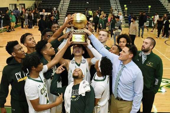The Cy Falls boys basketball team won the 2017-18 District 17-6A Championship under head coach Richard Flores.