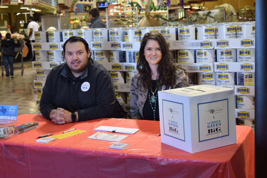 Rocky Rios and SyAnn Young, with Happy State Bank, took a voluntary shift collecting money for the Plainview Area Endowment Tuesday during the #GivingTuesdayLBK campaign. Photo: Ellysa Harris/Plainview Herald