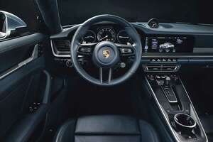 For the interior of the 2020 911, designers took inspiration from the 1970s 911s and came up with the 2020's expansive, horizontal lines. A central tachometer is flanked by two digital displays. (Porsche photo)