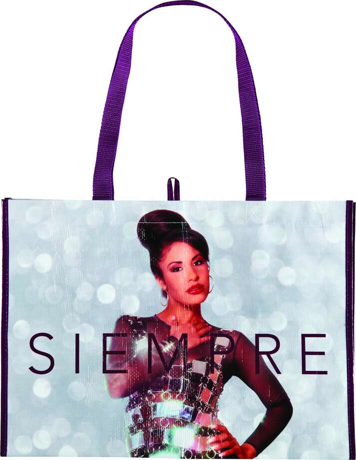 "H-E-B unveiled photos of the new bag on Thursday, showing Selena wearing the mirrored outfit with ""Siempre"" on one panel and the Selena logo on the other. The bags will be available at all H-E-B locations and online on Dec. 6. Photo: Courtesy, H-E-B"