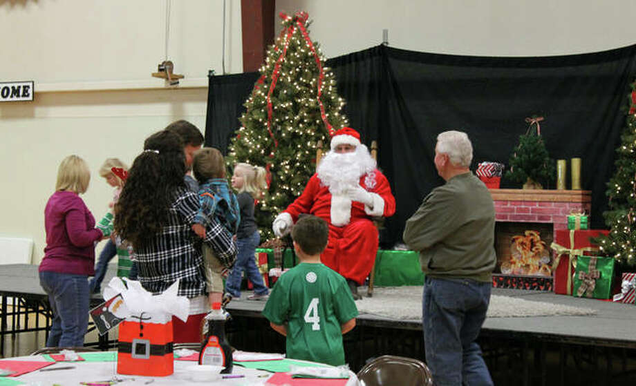 Sixth graders at St. Mary Catholic Grade School, 1802 Madison Ave. in Edwardsville, are hosting Breakfast with Santa on Saturday, Dec. 15 as a fundraiser for their trip to Space Camp next year. Children and a few adults gather around Santa Claus, pictured, at last year's festive event. This family-friendly event requires advanced registration by Friday, Dec. 7 (extended). Tickets for children 12 and under are $7; adults $8. Photos with Santa cost $5. Registration forms can be found at www.stmaryedw.org. For more information, contact the school at 618-656-1230. Photo: For The Intelligencer