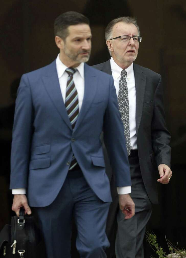 Daniel Lee Burke, right, leaves the John H. Wood Federal Courthouse on Thursday, with his attorney Jeffrey Ansley after being sentenced to five years of probation for wire fraud for intentionally inflating sales numbers at San Antonio-based software company Globalscape. Burke, the former vice president of global sales at Globalscape, pled guilty to the crime in May.