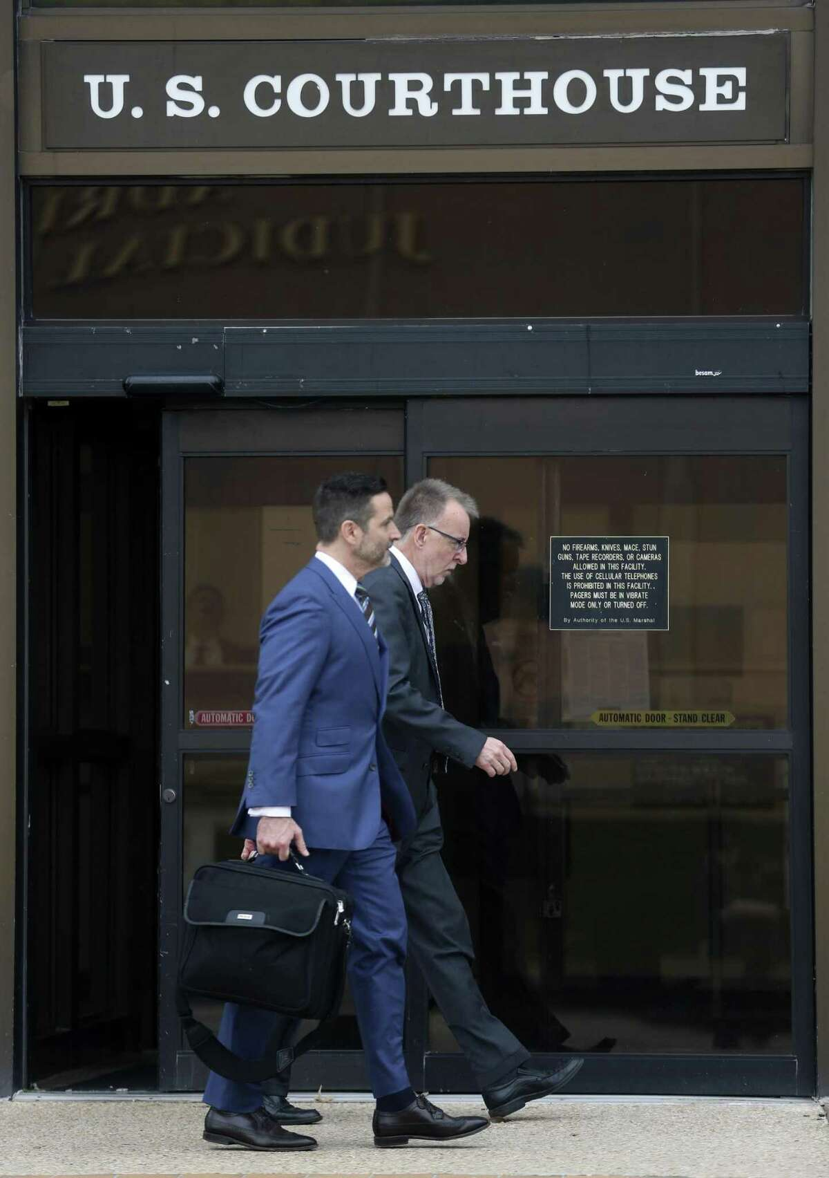 Daniel Lee Burke, right, leaves the John H. Wood Federal Courthouse on Thursday with his attorney Jeffrey Ansley after being sentenced to five years of probation for wire fraud.
