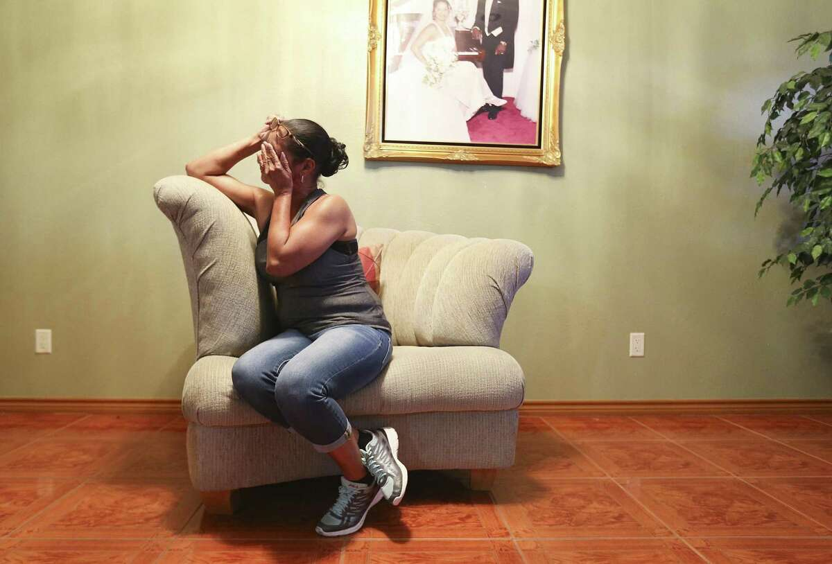 Marilyn Chambers wipes away tears as she talks about her husband, John, in her home on Friday, Nov. 16, 2018 in Houston. John Chambers died three months after receiving a double lung transplant at Baylor St. Luke's Medical Center.
