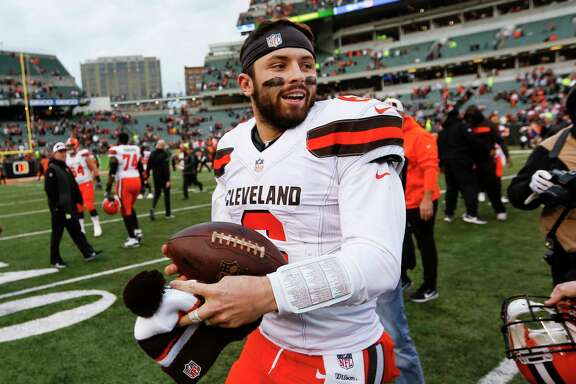 Cleveland Browns quarterback Baker Mayfield smiles after an NFL football game against the Cincinnati Bengals, Sunday, Nov. 25, 2018, in Cincinnati. (AP Photo/Frank Victores)