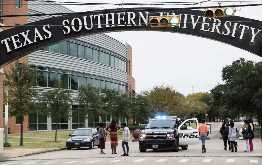 People stand outside one of the gates at Texas Southern University after the campus was evacuated due to a bomb threat on Wednesday, Nov. 28, 2018, in Houston. No explosives were found. >>Historically black colleges in Texas and the southeast and when they opened. Photo: Brett Coomer, Houston Chronicle / Staff Photographer / © 2018 Houston Chronicle
