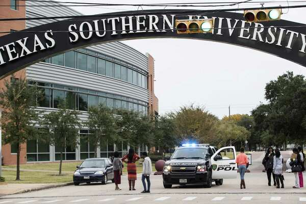 People stand outside one of the gates at Texas Southern University after the campus was evacuated due to a bomb threat on Wednesday, Nov. 28, 2018, in Houston. No explosives were found.