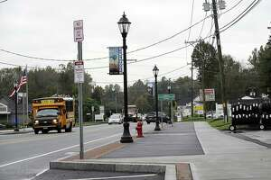 The Brookfield Streetscape project includes sidewalks and street lamps like the ones pictured here, just south of the four corners, Monday, Oct. 15, 2018.