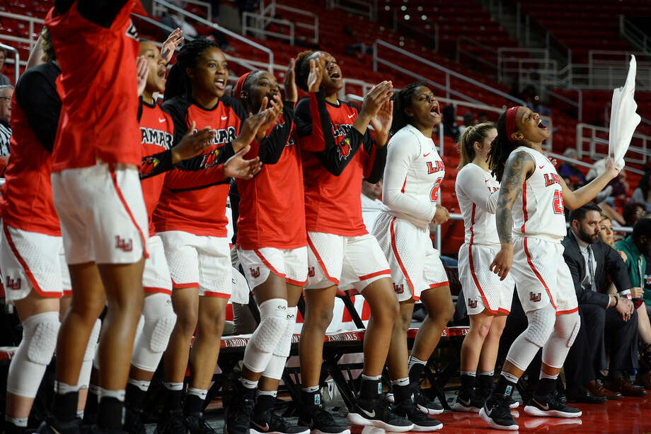 Lamar women's basketball players cheer from the bench during their final home game of the year against Houston Baptist. The team has been undefeated at home the past two years. 