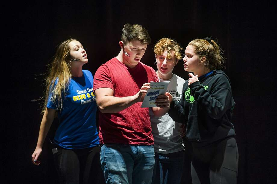 From left, emcees Emma Browne, Zion Lange, Rebecca Henning and Payton Stearns rehearse for Midland High's Rhapsody Rendezvous on Tuesday, Nov. 27, 2018 at Midland Center for the Arts. (Katy Kildee/kkildee@mdn.net) Photo: (Katy Kildee/kkildee@mdn.net)