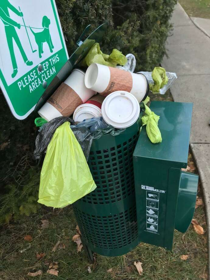 Thanksgiving weekend was not kind to the town's dog waste stations. Beer cans, coffee cups, and even a diaper were found inside the Main Street receptacles Sunday, Nov. 25. Photo: Contributed Photo / Ridgefield Press