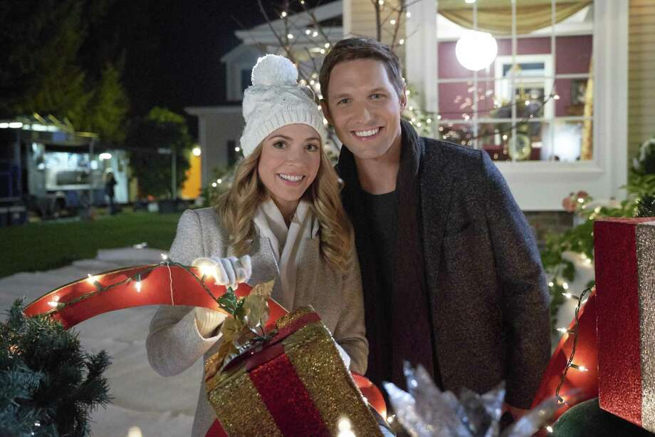 "Brooke Nevin and Michael Cassidy in ""Jingle Around the Clock."" Photo: Courtesy Crown Media Family Networks / Bettina Strauss / © Crown Media United States, LLC"