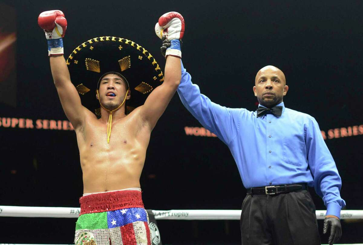 Kendo Castaneda celebrates his victory over Joe Sambrano in their welterweight match during the World Boxing Super Series event in the Alamodome on Saturday, Sept. 23, 2017.