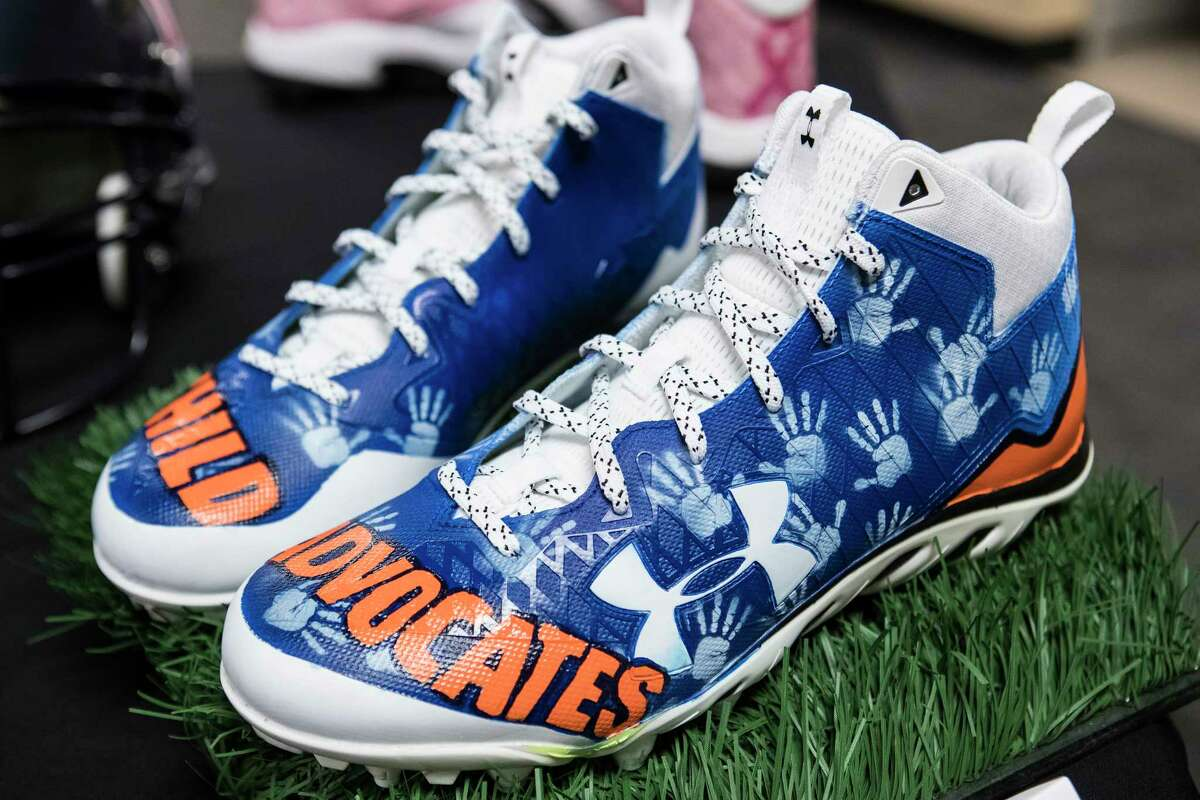 Houston Texans long snapper Jon Weeks' cleats, supporting Child Advocates, made for the annual